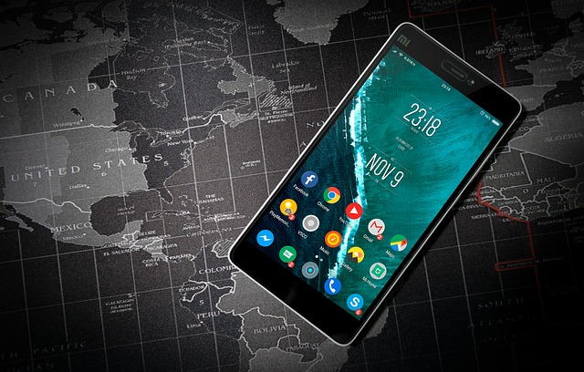 home screen of android mobile above world-map.