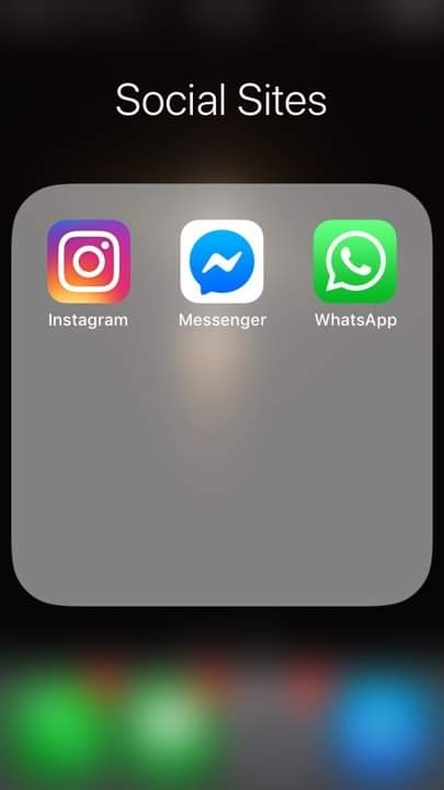 IOS icon of Instagram, Messenger, and WhatsApp in a folder name Social Sites.